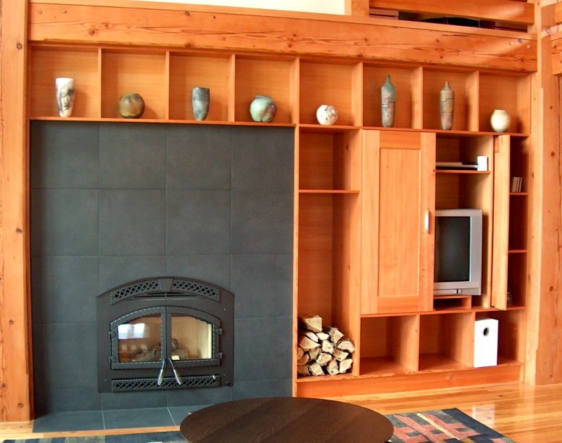 Open shelving was designed to mimic the size and shape of the tile surrounding the fireplace in an upstate NY home.