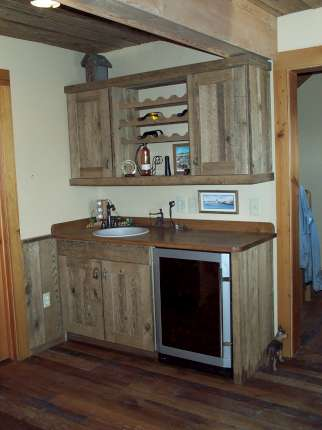 Weathered barn wood cabinets.