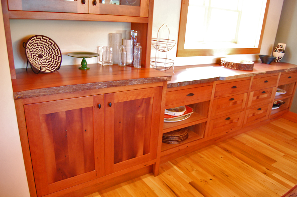 Reclaimed cherry counter with live edge on reclaimed cherry cabinetry.