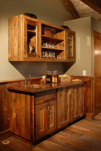 Pioneer Millworks' Grandmas Attic grade mixed softwoods were used to create a buffet/bar/cabinetry with copper top and paneling in this game room.