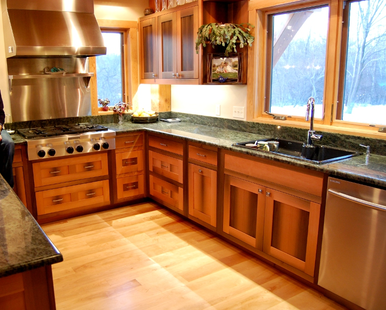 "Fondly called ""river fir"", Douglas fir salvaged from river bottoms shows character from its time down below in this Fairport NY kitchen."