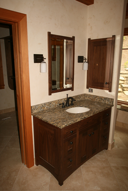 FSC Certified walnut vanity, mirror, and medicine cabinet.