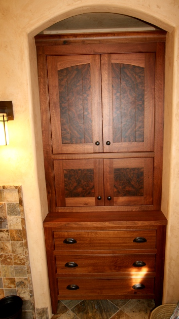 Burled walnut insets steal the stage in this custom walnut cabinet.