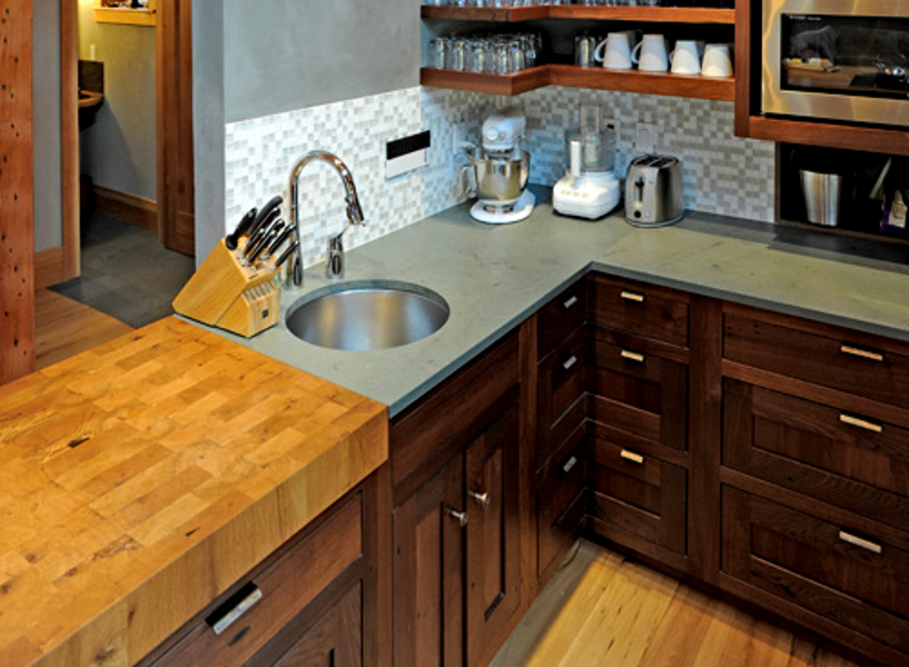 A wooden chop block counter flows to natural Sheldon Slate in a Portland OR kitchen.