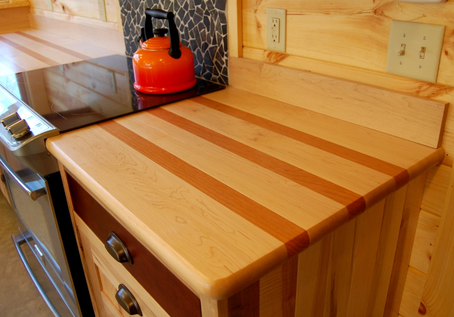 As the maple and cherry wood of this countertop mature the contrasting species' colors will become deeper and more obvious.