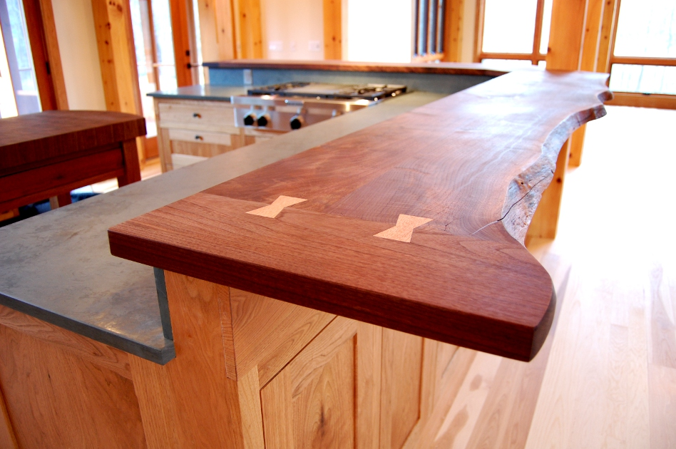 This live edge Walnut top feautres Butternut butterfly joints and tops custom Butternut cabinetry for a kitchen in Mendon, NY.