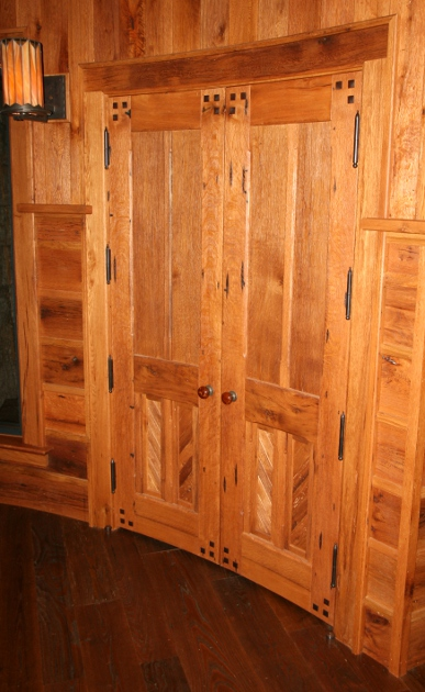 Reclaimed oak doors on the interior of a zen center are curved to match the slope of the surrounding walls. D29