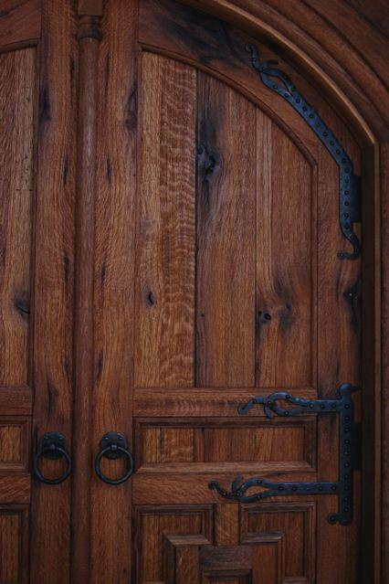 Reclaimed oak shows character marks, deep patina and tight grain patterns. These doors are both arched and curved to meet the circular walls of this meditation center. D1