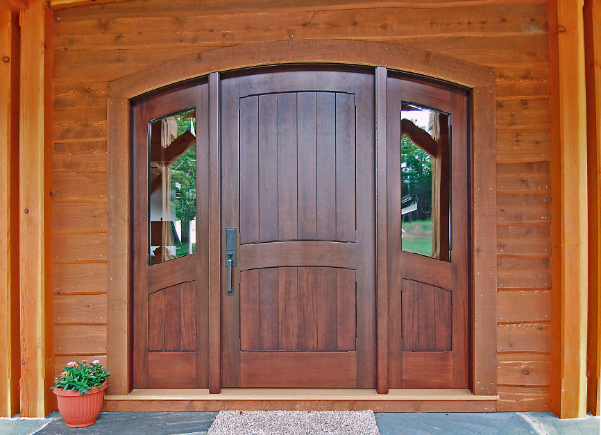 Custom walnut door on lakeside timber frame home. D43