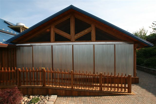 Custom metal and wood doors shown closed on this pavilion in upstate NY. D38