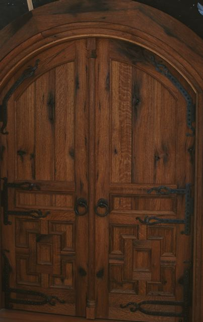 Reclaimed oak shows character marks, deep patina and tight grain patterns. These doors are both arched and curved to meet the circular walls of this meditiaion center. D25