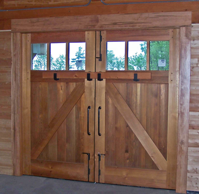 Barn doors with old style bolt locks. D32