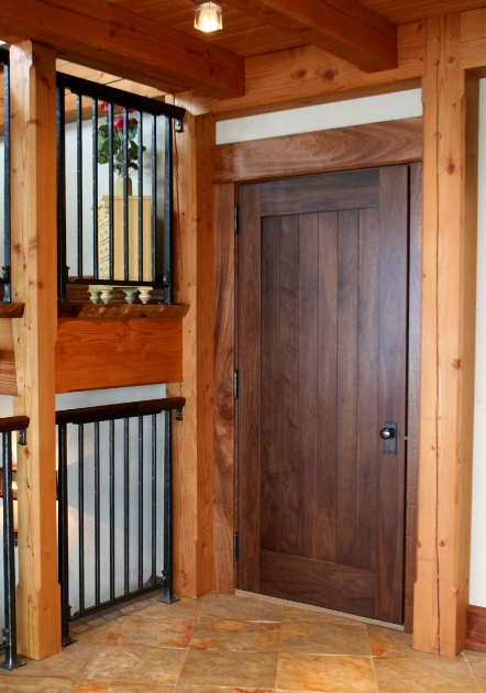 Eastern Walnut doors compliment the Douglas fir timber frame of this carriage house. D51
