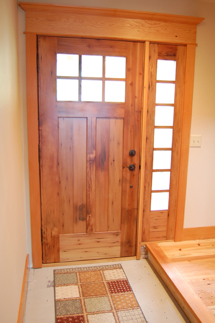 The squares of the door window are repeated in the sidelight creating balance and continuity.