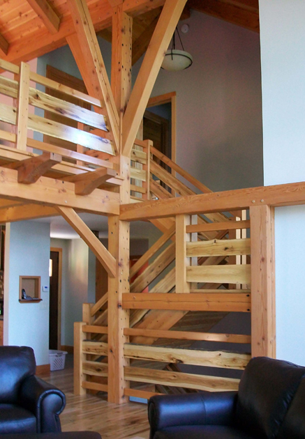 Live edge reclaimed hickory stair railings combine with Douglas fir in a timber frame home.