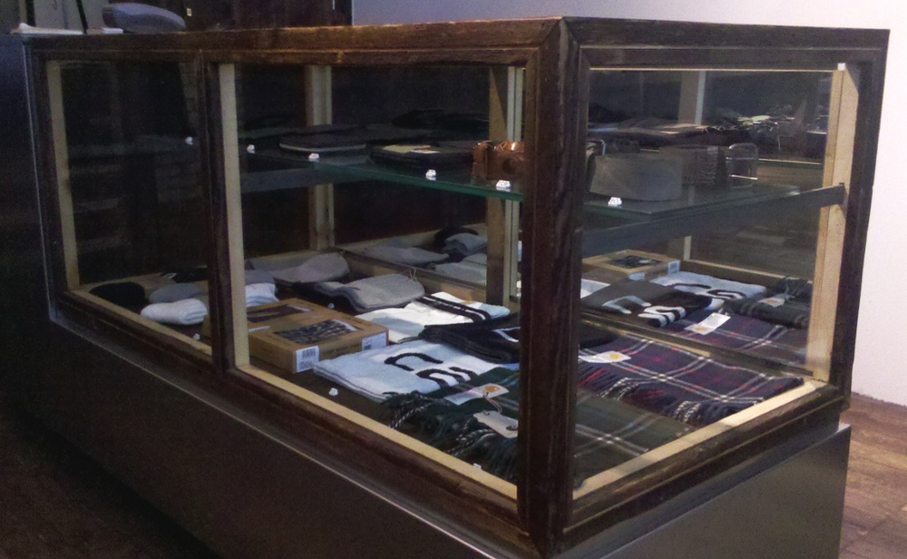 This may look like a traditional glass and wood display case, yet the wood has a very interesting history - it was salvaged from the Essex County Jail Complex in NJ. F17