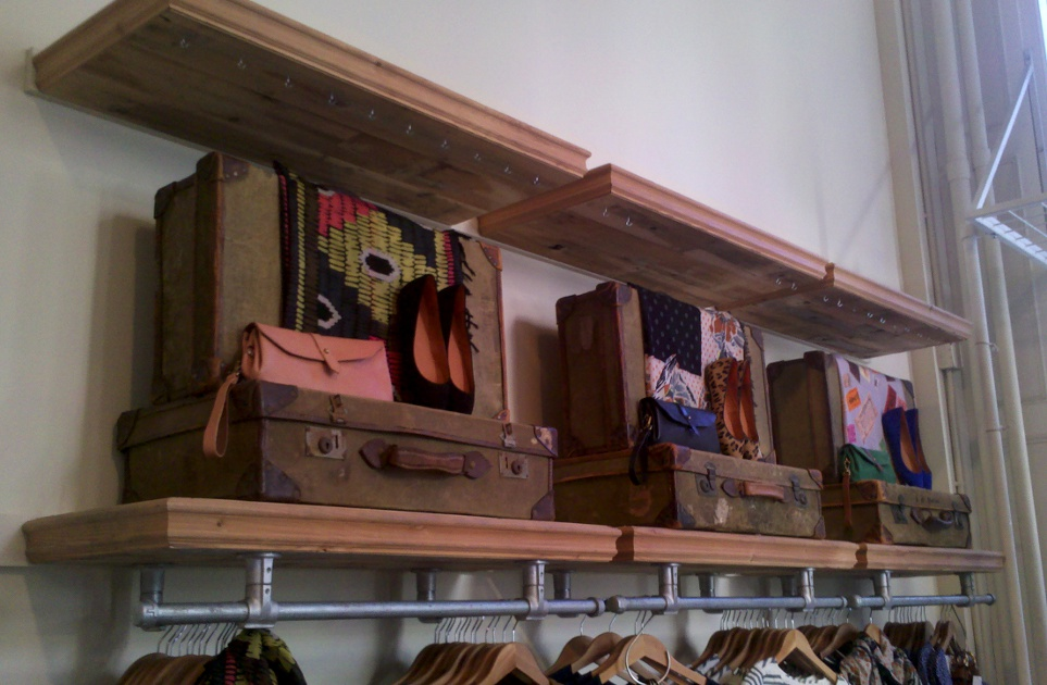 Reclaimed mixed softwoods were crafted into shelving for a women's clothing retailer. F10