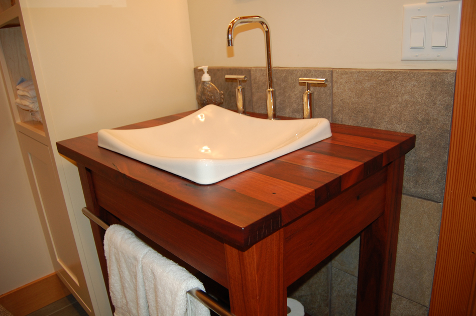 Reclaimed exotic hardwood, Jarrah, brings color and character to this Keuka Lake home's guest bathroom.