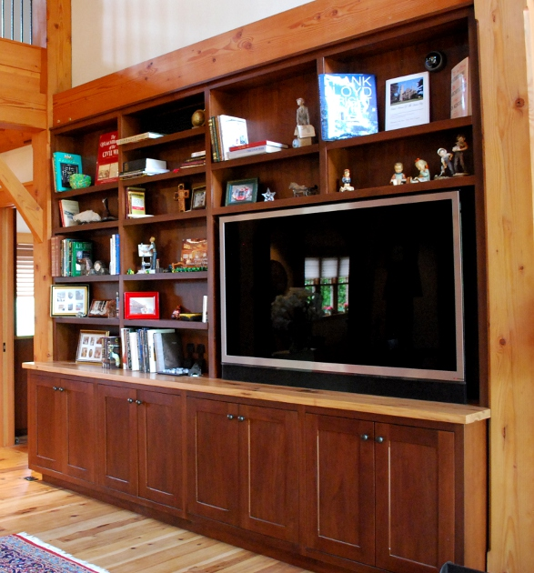 A rather large piece of furniture, this walnut entertainment unit offers open and enclosed storage space.