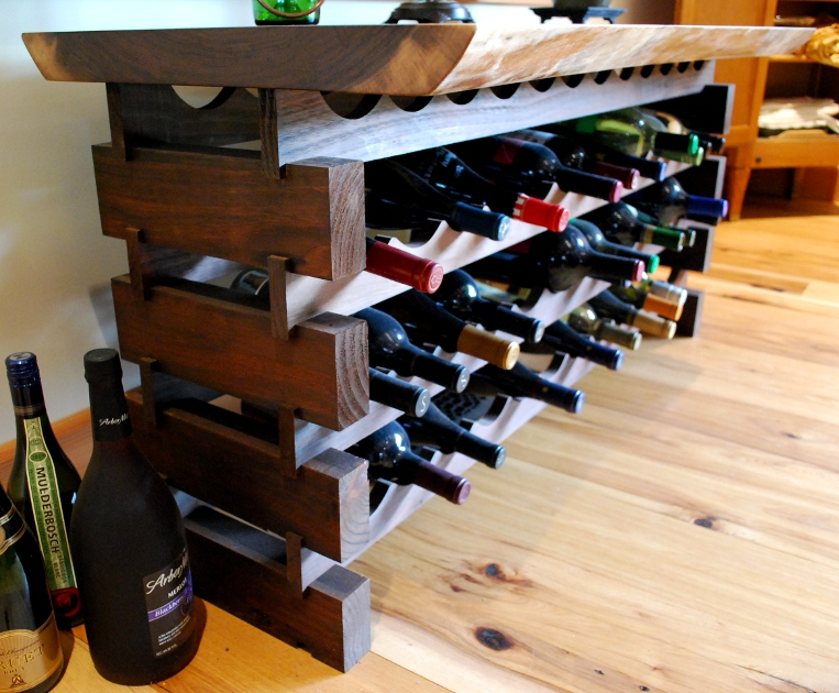 A custom walnut wine storage rack also serves as a table in this dining room. W5