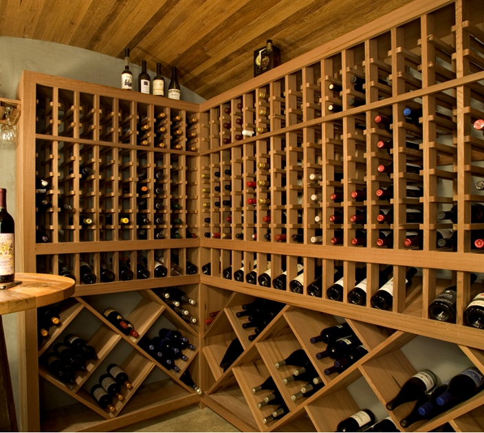 This wine cellar includes a curved ceiling clad with reclaimed wine vat stock wood. W1