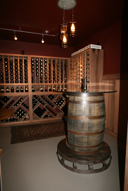 A reclaimed wine vat was re-purposed as a tasting table in this New York home. W11