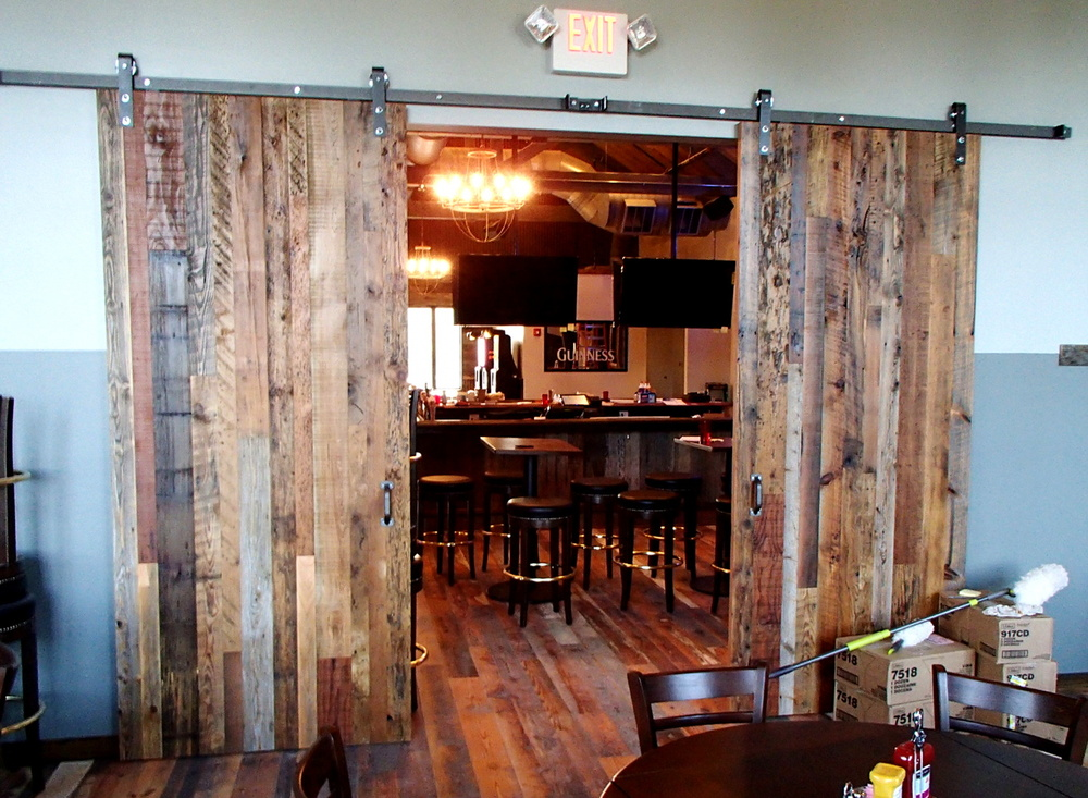 Mixed reclaimed wood planks were crafted into divider doors for a tavern in Penfield, NY. D45