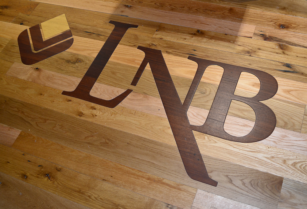 Lyons National Bank custom inlay blends seamlessly with the reclaimed American Gothic Oak flooring.