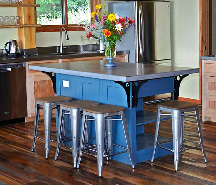 This blue island with a cement top lends a pop of color in a custom lake vacation home.