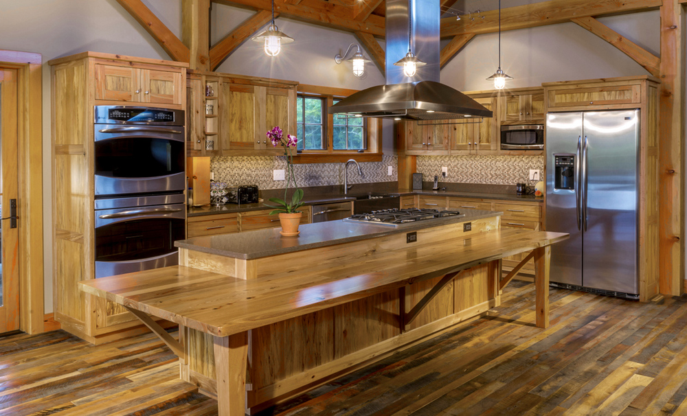 Reclaimed beech stiles/rails and reclaimed spalted beech panels bring character and history to a handicap accessible family kitchen.