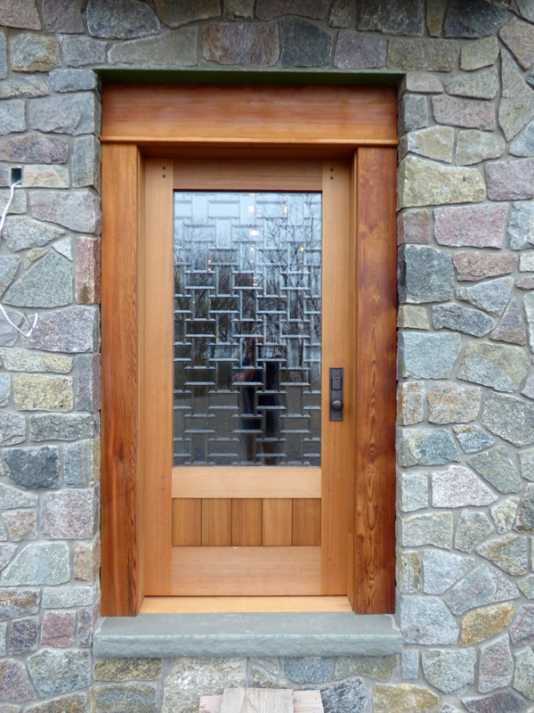 Cedar door with custom glass insert.