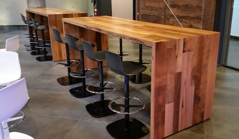 Communal tables crafted of reclaimed hardwoods for BankUnited in Florida.