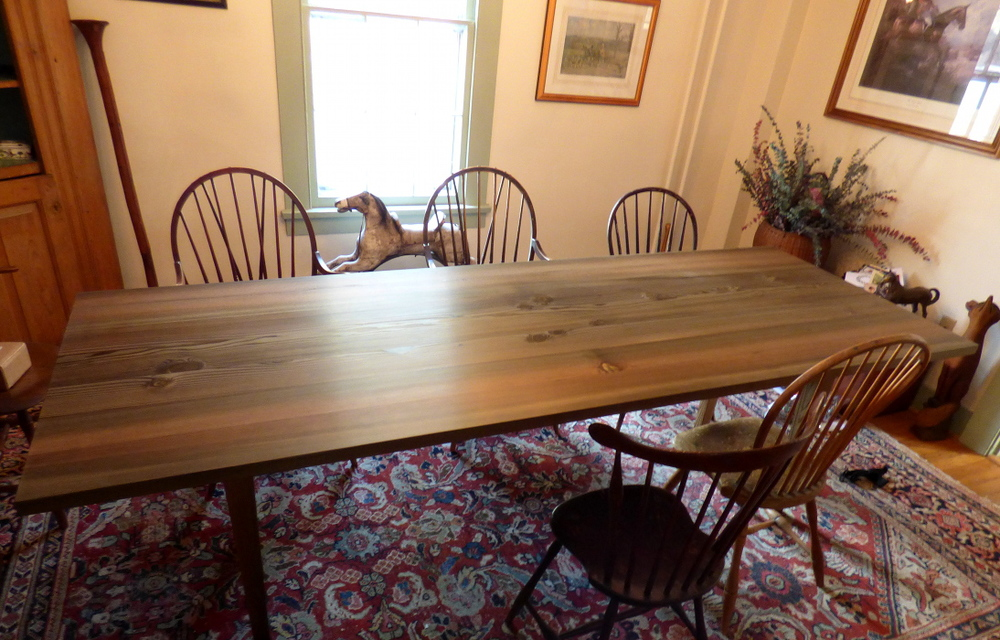 Reclaimed Douglas fir dining table with hand wiped oil finish comfortably seats eight.
