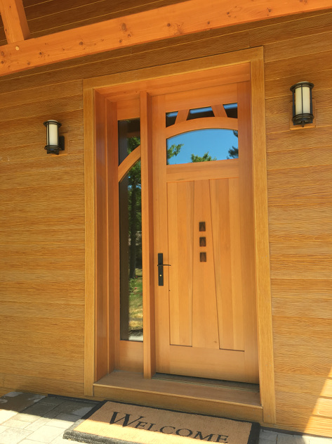 The curve in this door was inspired by the curve of the timber overhead. We used clear grain Douglas fir with Walnut accents to bring the design to life.