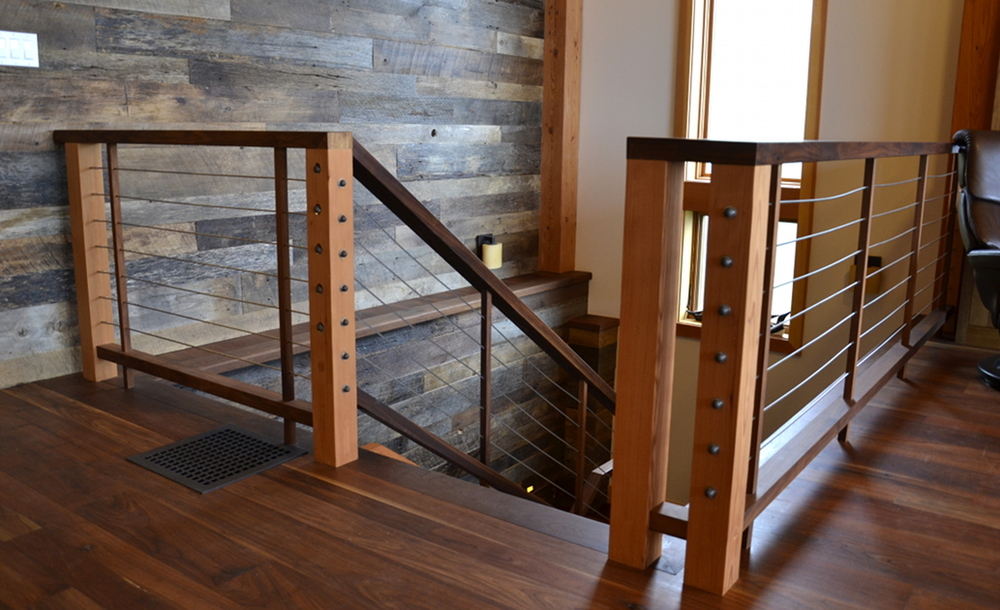 Custom Stair Railing Of Douglas Fir, Walnut, And Stainless Steal Cable Rails