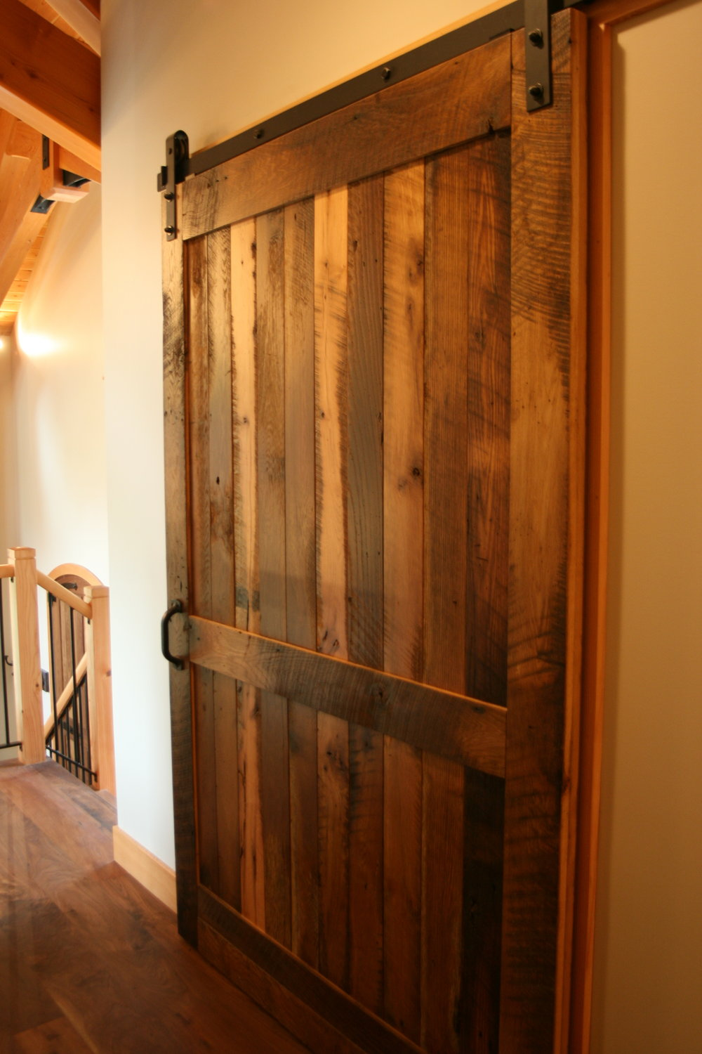 Settlers' Plank Flat Track Door conceals the laundry room