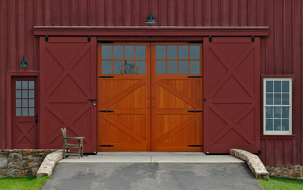 Custom barn doors for a large timber frame barn in Poolsville, MD.