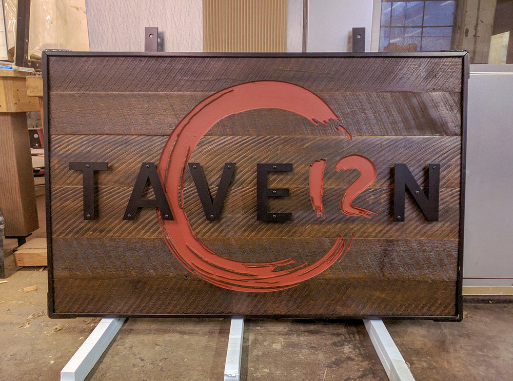 Reclaimed wood sign with custom metal work