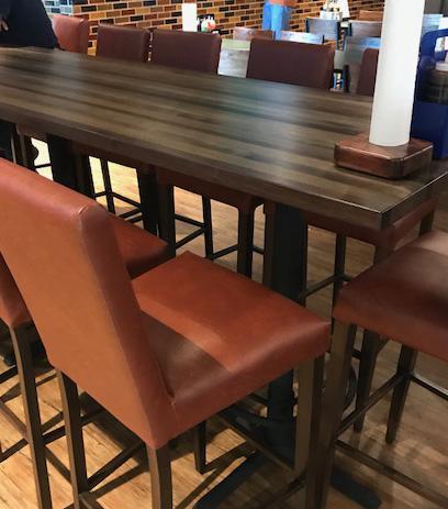 Communal bar-height restaurant table