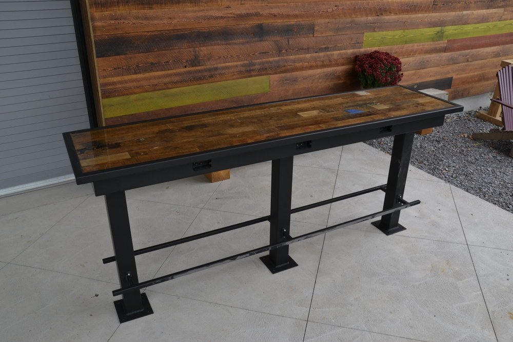 Bar-height table with reclaimed foundry maple top
