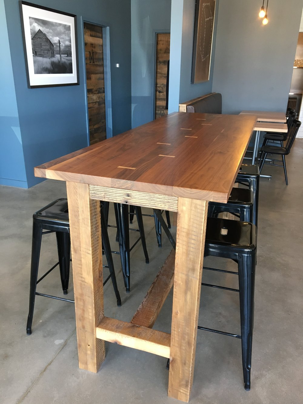 Bar height table with contrasting bow ties