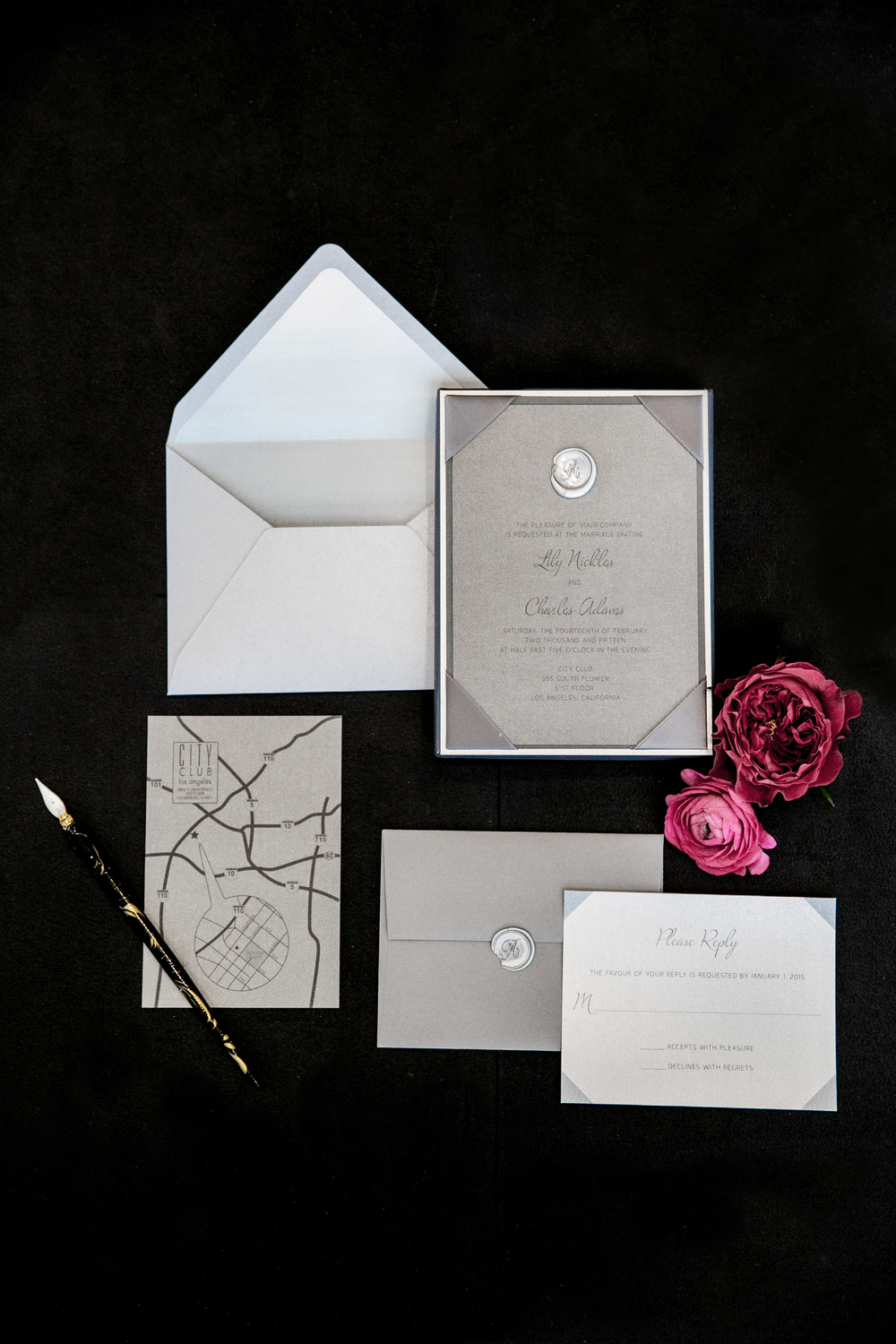 Grey monochromatic invitation with wax seal details.