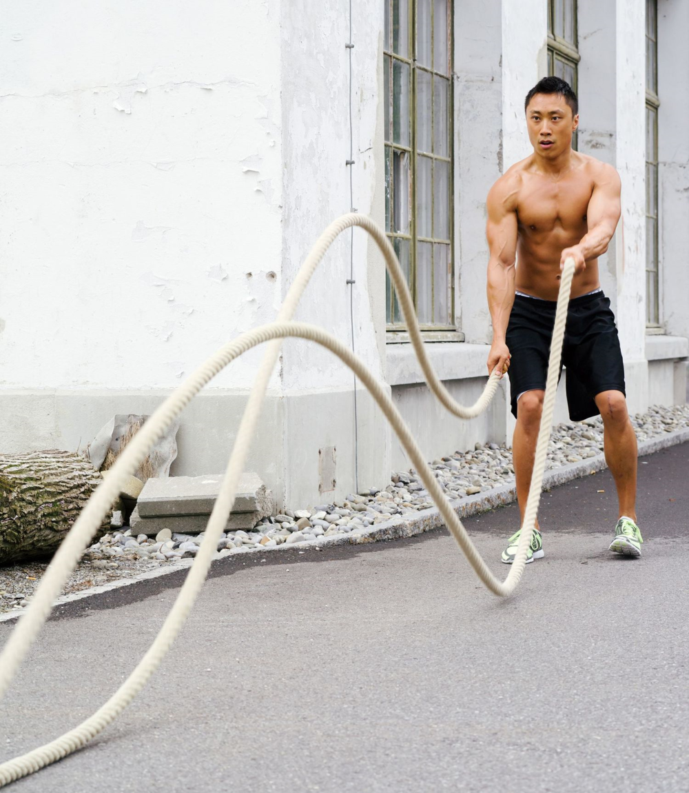Man exercising with battle ropes