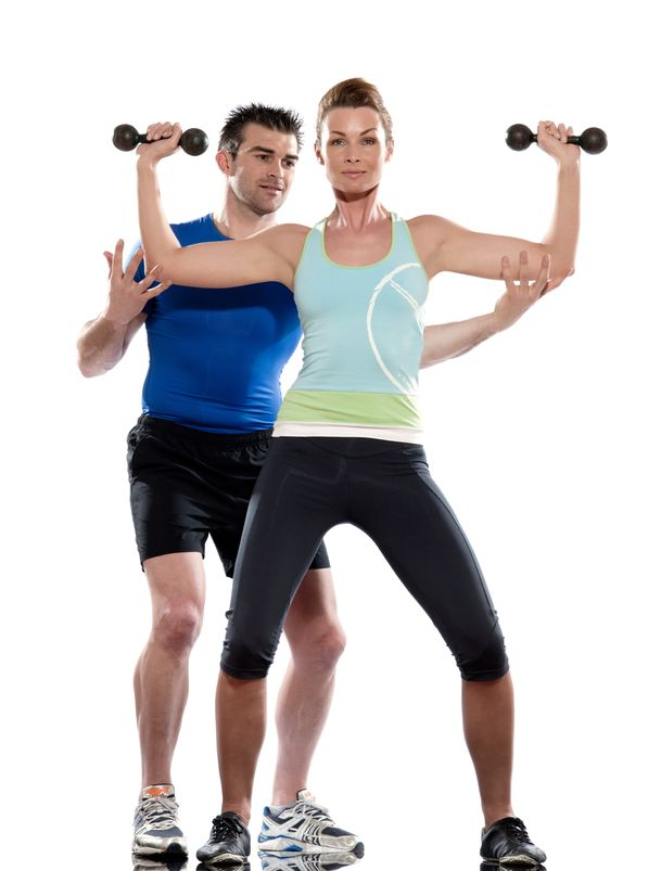 Male Trainer helping female client - Personal Trainer Studio City