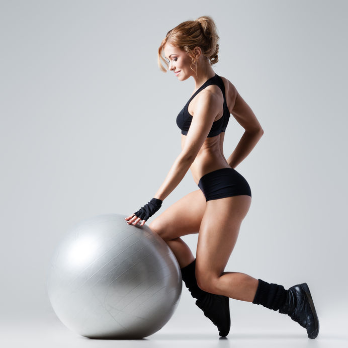 Female on exercise stability ball - Ultimate Health Personal Trainer - Los Angeles - Studio City