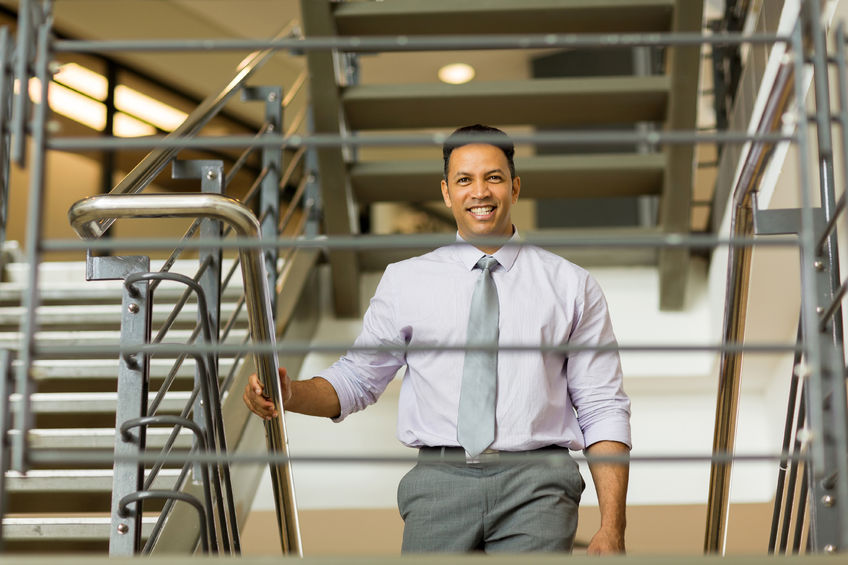 Business man walking up staircase-Ultimate Health - Personal Trainer Hollywood - Studio City