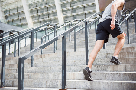 Man running up stairs in shorts