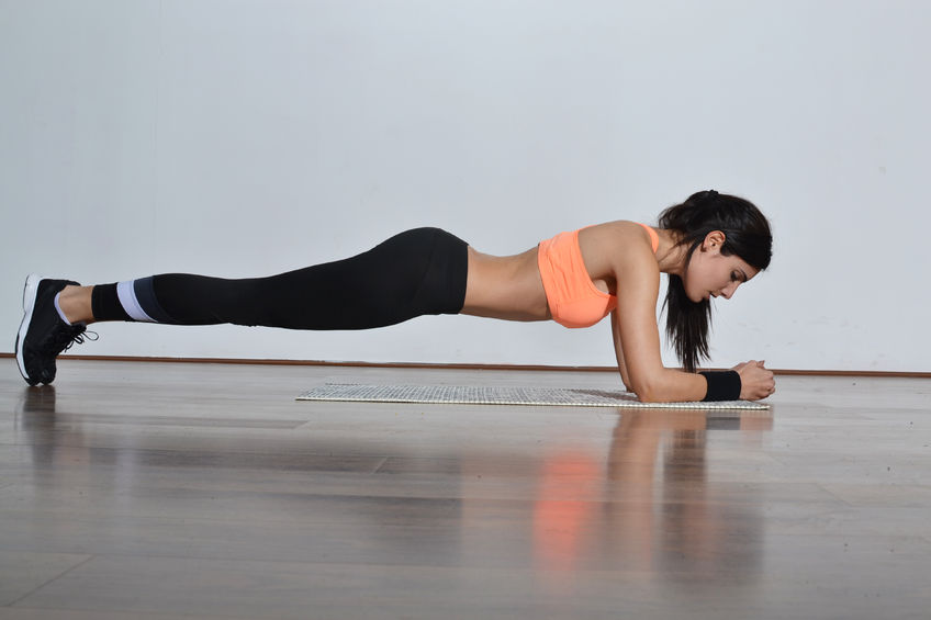Woman doing a plank - Ultimate Health Personal Trainer - Hollywood