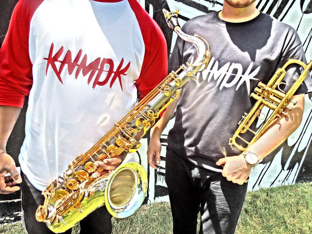 Knomadik Horns are: De'Sean Jones (tenor saxophone/EWI), Aaron Janik (trumpet/flugelhorn/effects), and Lawrence Galloway (trombone)