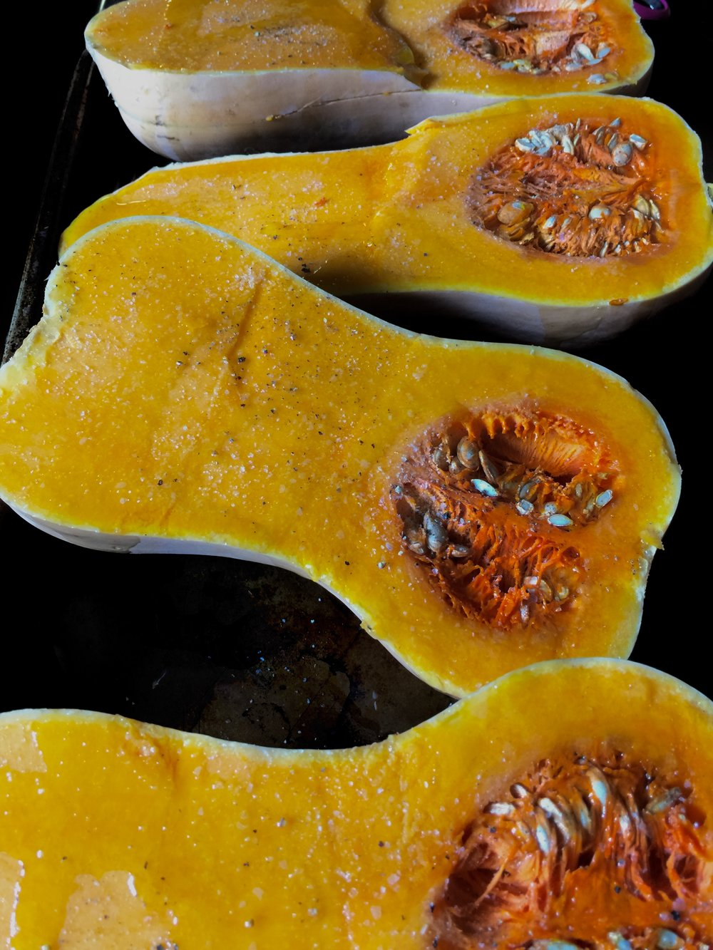 Prepping the beautiful and in-season butternut squash for roasting.